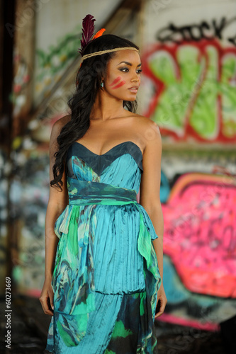Indian Cherokee woman posing in front of abstract background