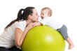 mother and baby having fun with gymnastic ball