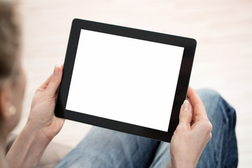 Close up of young woman using digital tablet with copy space