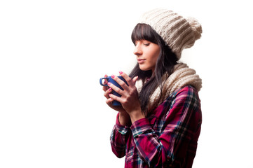 a cold woman drinking a hot drink