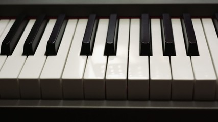 dolly shot of a piano keyboard