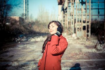 beautiful woman red coat listening music park
