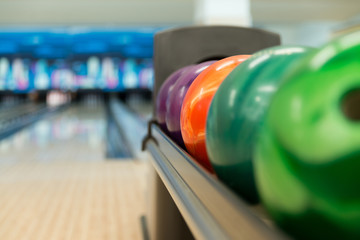 Rack Of Colorful Balls At A Bowling Alley