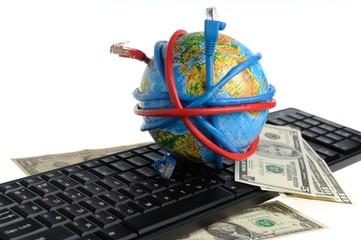 Глобус обмотанный проводами, доллары на клавиатуре на белом фоне