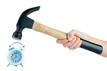 Hammer in hand and alarm clock isolated on white