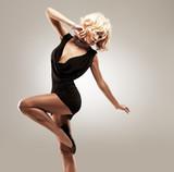 Fototapety Beautiful female dancer  in black dress