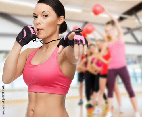 woman with whistle in gym