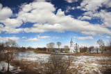 Ice drift on the river in Russia, the church on the shore, the i