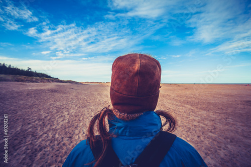 Hiker looking at blue sky