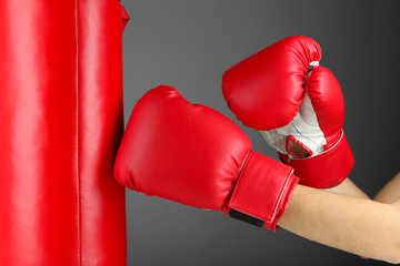 Box training and punching bag, on color background