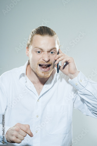 young man discussing on the phone