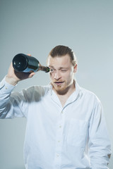 young man drinking alkohol