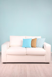 Fototapety White sofa in room on blue background
