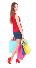 Beautiful young woman holding shopping bags isolated on white