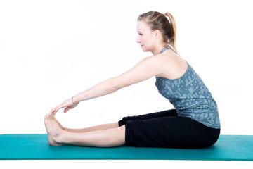Junge Frau beim Sport / Fitnessübungen / Training