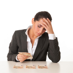 Worried businesswoman with banknotes against white background.