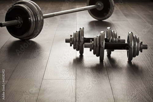 Tuinposter Gymnastiek dumbells for fitness on wooden floor
