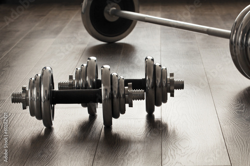 dumbells for fitness on wooden floor