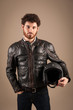 Confident young man portrait with leather jacket and helmet agai
