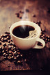 Steaming cup of freshly brewed coffee. Shallow depth of field