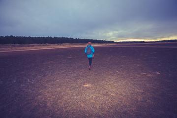 Hiker walking across a wet terrain