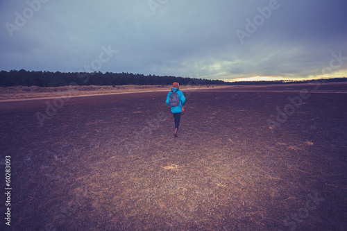 Hiker walking across a wet terrain