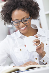 African American Woman Drinking Coffee Reading Book