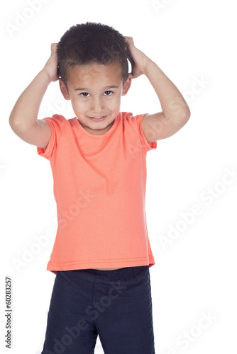 little boy scratching his head