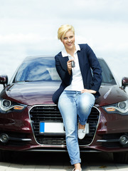 Woman proudly presents the key of her car