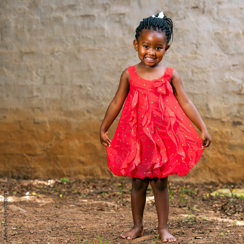 African girl showing red dress.