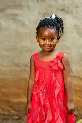 Cute african youngster in red dress.