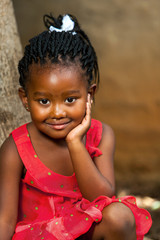 Face shot of cute african girl.