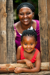 Happy african girl with mother.