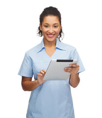 smiling black doctor or nurse with tablet pc