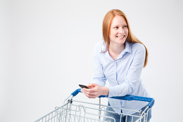 Woman Grocery Shopping with a Smartphone
