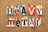 The phrase Heavy Metal on a cork notice board