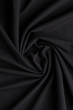 Spiral folds on black cloth