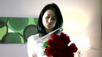 Beautiful woman giving flowers feeling guilty