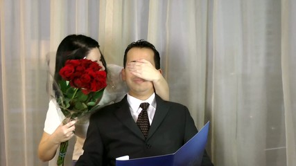 Woman preparing surprise to a man and the man get scared.