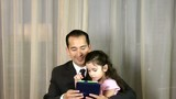 Man with daughter playing with digital tablet