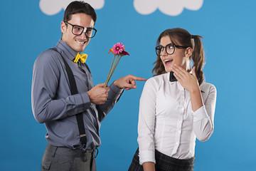Portrait of flirting nerdy couple