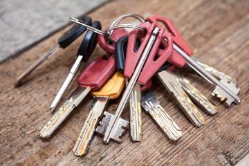 Several keys on wooden background
