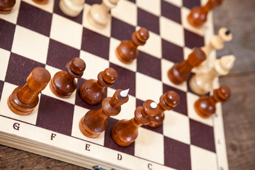 Chess on wooden board, playing unfinished game
