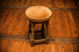 Antique stool on wooden floor