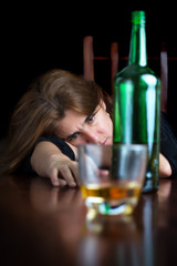 Dark emotional image of a sad drunk woman