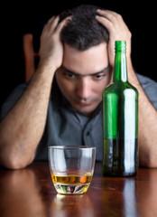 Depressed drunk man suffering a headache