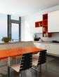 Modern kitchen interior with orange and white furniture