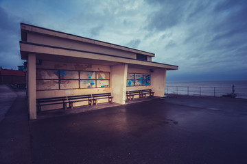 Old building on promenade next to the sea