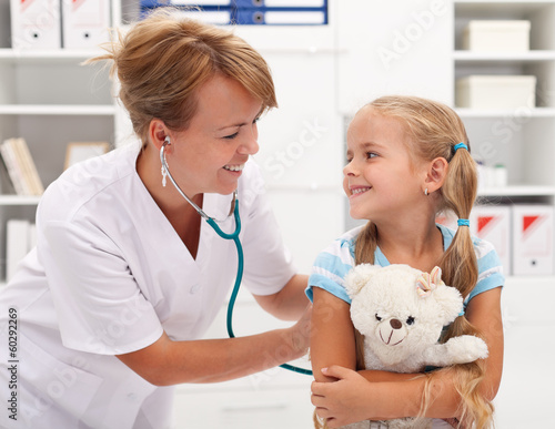 Little girl at the doctor for a checkup examination