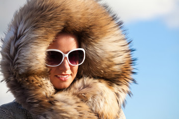 Beauty Fashion Model Girl in Fur Coat.